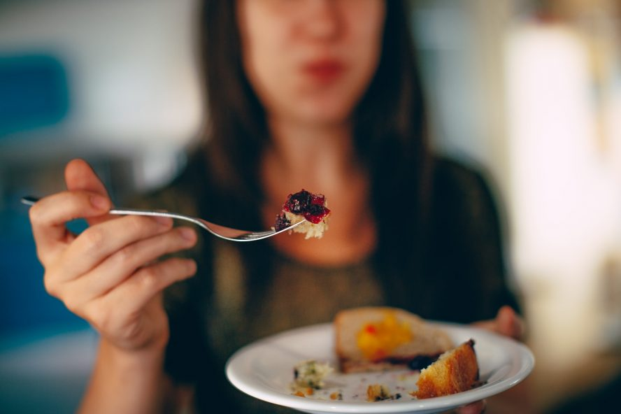 woman holding plate of cake